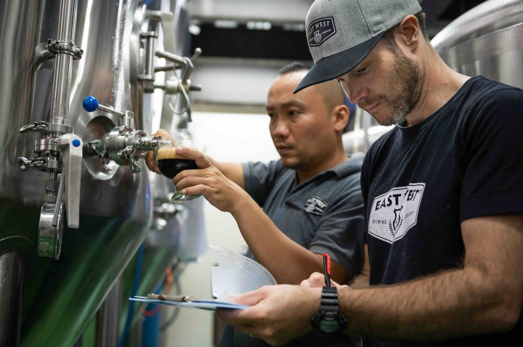 Technical inspection during the brewing process at East West Brewing.